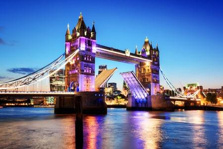 drawbridge: Tower Bridge in London, the UK. Night lights at late sunset. Drawbridge opening. One of English symbols Stock Photo