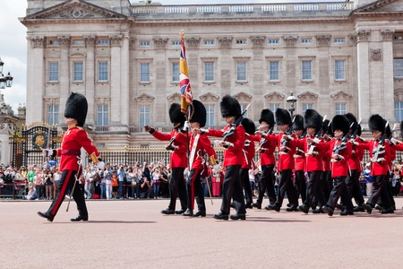 buckingham palace: LONDON - JUNE 24: British Royal guards perform the Changing of the Guard in Buckingham Palace on June 24, 2015 in London, UK. Queens Guard change is one of the major tourist attraction in England Editorial