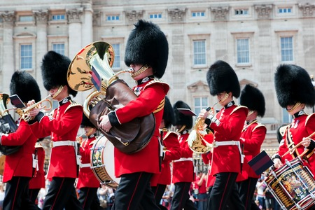 buckingham palace: LONDON - JUNE 24: British Royal guards, the Military Band perform the Changing of the Guard in Buckingham Palace on June 24, 2015 in London, UK. Queens Guard change is one of the major tourist attraction in England