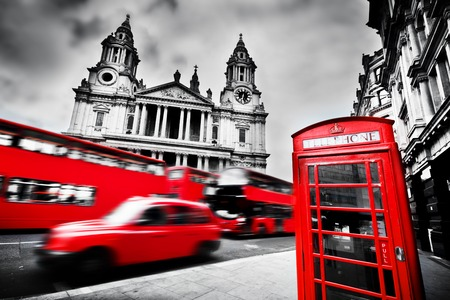 black and red: St Pauls Cathedral facade, red bus, taxi cab and red telephone booth. Symbols of London, the UK. Black and white Editorial