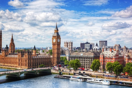 Big Ben, Westminster Bridge on River Thames in London, the UK. English symbol. Lovely puffy clouds, sunny day