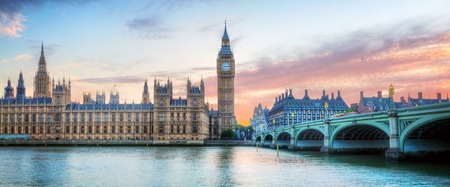 London, UK panorama. Big Ben in Westminster Palace on River Thames at beautiful sunset.