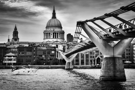 st pauls: St Pauls Cathedral dome seen from Millenium Bridge in London, the UK. Black and white