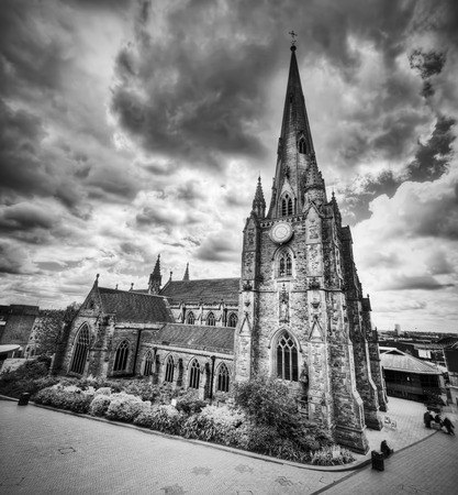 bull ring: St Martin in the Bull Ring church in Birmingham, England, the UK. Wide angle, Black and white Stock Photo