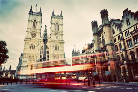 abbey: Westminster Abbey church facade, red bus moving in London UK. Symbols of England, Great Britain. Vintage, retro style.