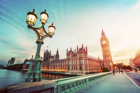 tower house: Big Ben seen from Westminster Bridge, London, the UK. at sunset. Retro street lamp light. Vintage Stock Photo