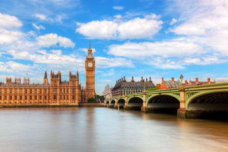 famous: Big Ben, Westminster Bridge on River Thames in London, England, UK. English symbol. Sunny day with puffy clouds