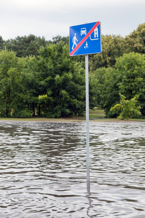 submerged: Road sign submerged in flood water on July 28, 2015 in Gdansk, Poland. Storms and heavy rains hit many parts of Poland and Europe