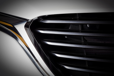 metal parts: Modern luxury car close-up of grille. Background, concept of expensive, sports auto detailing