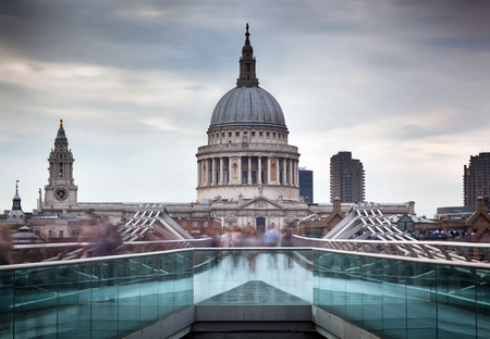 st pauls: St Pauls Cathedral dome seen from Millenium Bridge in London, the UK. Cloudy sky Stock Photo