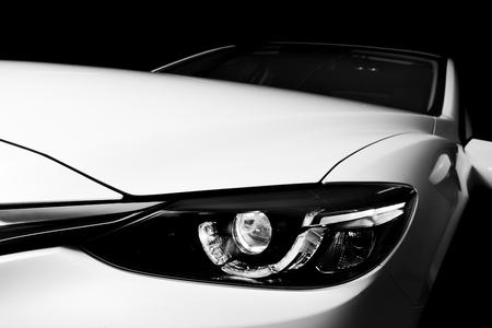 Modern luxury car close-up background. Concept of expensive, sports auto, detailing. Black and white
