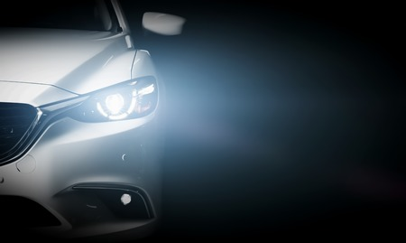 headlights: Modern luxury car close-up banner background. Concept of expensive, sports auto. Editorial