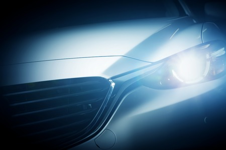 headlight: Modern luxury car close-up background. Concept of expensive, sports auto.