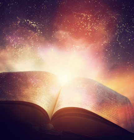 Open old book merged with magic galaxy sky, universe, stars. Concept of literature, fantasy, horoscope, religion etc. Stock Photo