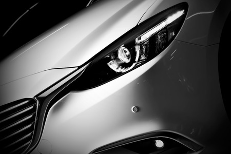Modern luxury car close-up background. Concept of expensive, sports auto.