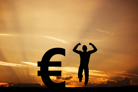 financial symbol: Happy man jumping for joy next to EURO symbol. Winner of lottery, financial business success concept Stock Photo