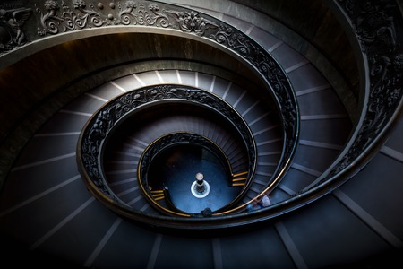 elegant staircase: Long spiral, winding stairs. Dark shadows, mysterious mood with single soft light.