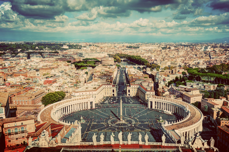 st  peter's basilica pope: St. Peters Square, Piazza San Pietro in Vatican City. Rome, Italy in the background. View from St. Peters Basilica dome. Vintage Stock Photo