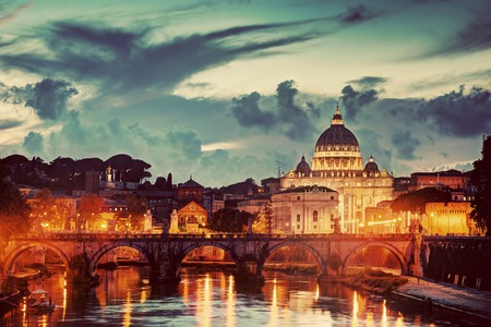 basilica: St. Peters Basilica in Vatican City and Ponte SantAngelo bridge over Tiber river in Rome, Italy in the evening