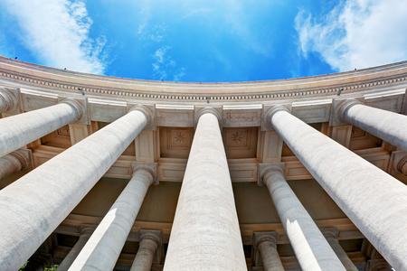 columns: St. Peters Basilica colonnades, columns in Vatican City. Blue sky