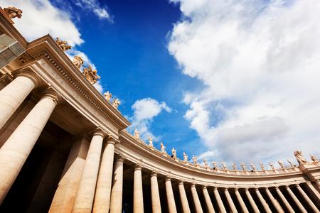 peters: St. Peters Basilica colonnades, columns in Vatican City. Blue sky