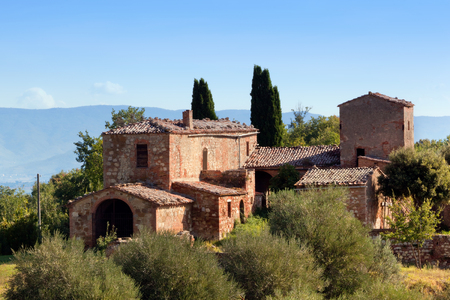 tuscan house: A residence in Tuscany, Italy. Typical for the region tuscan farm house, hills, cypress trees. Italy Editorial
