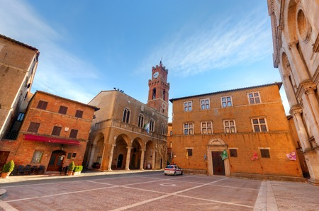 pienza: Old town of Pienza in Tuscany, Italy. Historic city center. Blue morning sky