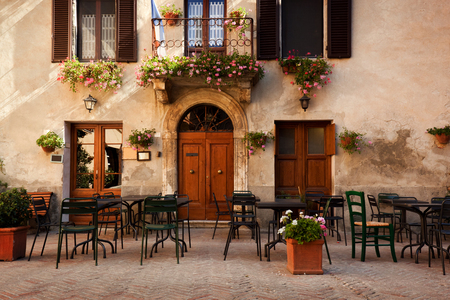Retro romantic restaurant, cafe in a small Italian town. Vintage Italy, outdoor trattoria Banco de Imagens - 47060572