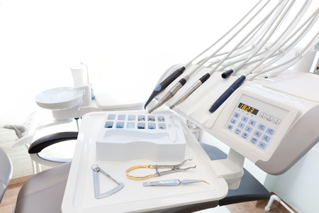 scaler: Equipment and dental instruments in dentists office. Tools close-up. Dentistry