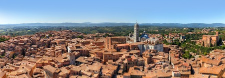 siena italy: Siena, Italy panorama rooftop city view. Siena Cathedral, Duomo di Siena as seen from Mangia Tower, Italian Torre del Mangia. Tuscany region landscape