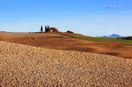 san quirico d'orcia: Tuscany landscape. Field, farm house among cypress trees. Italy. Blue sunny sky Editorial