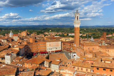 the tuscany: Siena, Italy rooftop city panorama. Mangia Tower, Italian Torre del Mangia. Medieval architecture. Tuscany region Stock Photo