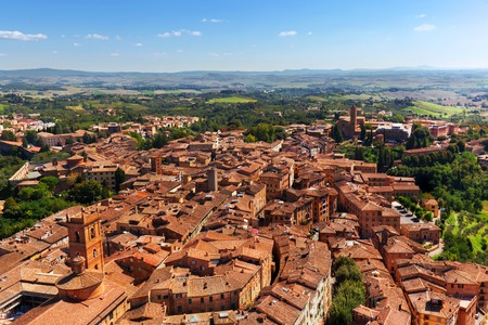 italian architecture: Siena, Italy panoramic rooftop city view. Medieval architecture. As seen from Mangia Tower, Italian Torre del Mangia. Tuscany region Stock Photo