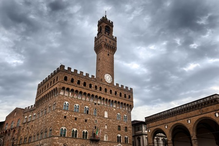 vechio: Palazzo Vecchio in Florence, Italy on a cloudy day. Dramatic sky in Italian Firenze