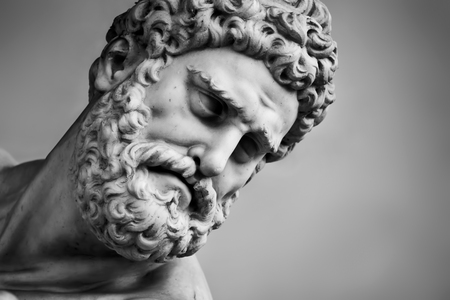 Ancient head close-up sculpture of Hercules and Nessus in Loggia dei Lanzi in Florence, Italy. Black and white