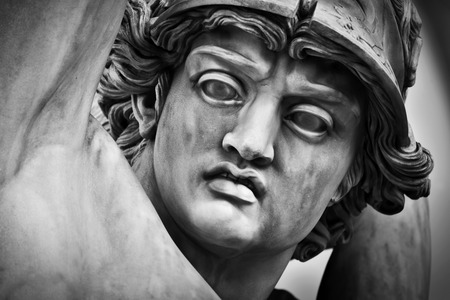sculpture: Ancient head close-up sculpture of The Rape of Polyxena in Loggia dei Lanzi in Florence, Italy. Black and white,