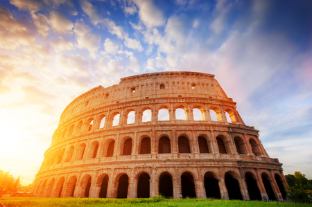 rome: Colosseum in Rome, Italy. Symbol of the ancient city. Amphitheatre in sunrise light.