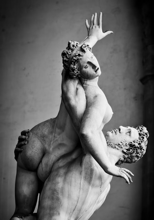 sculpture: Ancient style sculpture of The Rape of the Sabine Women in Loggia dei Lanzi in Florence, Italy. Black and white Stock Photo