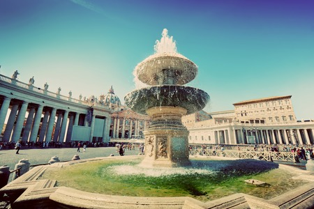 st  peter's square: Fountain on St. Peters square in Vatican City. Piazza San Pietro and Basilica. Vintage Stock Photo