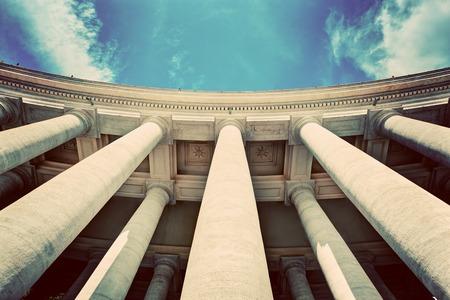 st  peter's basilica pope: St. Peters Basilica colonnades, columns in Vatican City. Blue sky, vintage