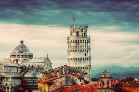 unique: Pisa Cathedral with the Leaning Tower panorama. Unique vintage perspestive from rooftop, dark clouds. Tuscany, Italy
