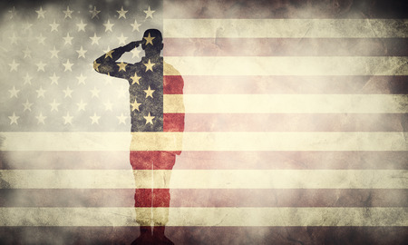 Double exposure of saluting soldier on USA grunge flag. Vintage, retro style. Patriotic design 写真素材