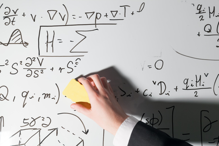 complex: Whiping the whiteboard. Complex math formulas. Mathematics and science with economics concept. Real equations, symbols handwritten by a professional.