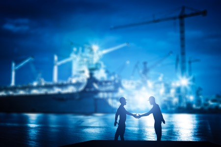 business partnership: Business handshake in shipyard, shipbuilding company. Industry, deal, contract.