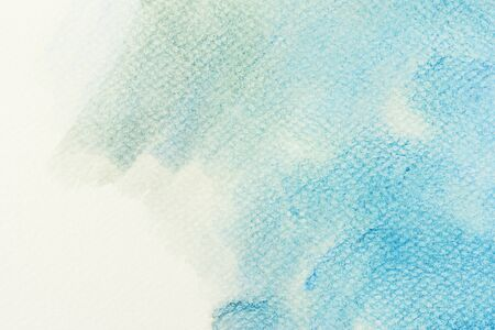 abstract paint: Blue watercolor paint on canvas. Abstract art background for creative design.