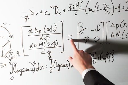 Teacher Pointing Finger On Equality Math Symbol On Whiteboard