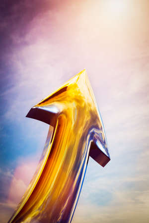 bright future: Golden arrow pointing, growing to the sky. Conceptual growth, bright future, progress. Stock Photo