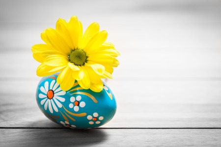 unique: Hand painted Easter egg and spring daisy flower on wood. Rustic minimalist composition, vintage