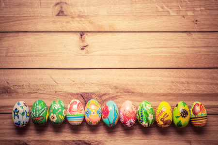unique: Colorful hand painted Easter eggs on wood. Traditional decoration, unique handmade design. Vintage