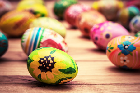 Colorful hand painted Easter eggs on wood. Traditional decoration, unique handmade design. Vintage Stock fotó - 50832688